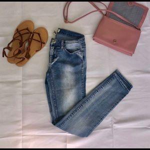 Mudd Juniors faded jeans.